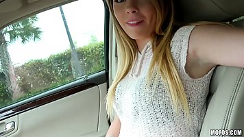 Cute girl is playing with a rock hard dick in the car, just ...