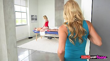 Petite blonde in red is having a threesome with her busty st...