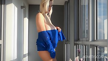 Naughty blonde bitch in blue with very big boobs is posing, ...