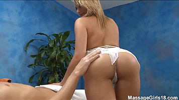 Gorgeous blonde masseuse is sucking her client's di...