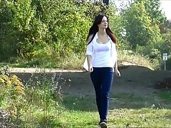 Fresh German brunette took off her clothes in the nature and...