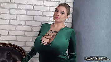 Vivian Blush is wearing a green dress and teasing a bit with...