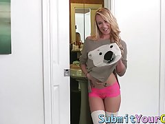 Great looking girl with blonde hair is rubbing her pussy to ...