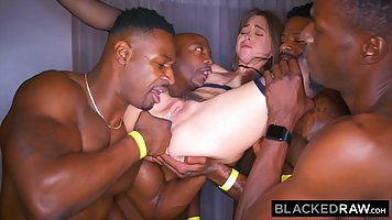 Teen girl is getting banged by a bunch of black horny men in...