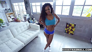 Hot ebony babe with long, curly hair is having sex with a wh...