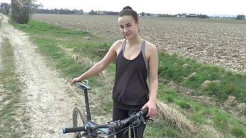 Cute brunette was riding a bike in the nature when she exper...
