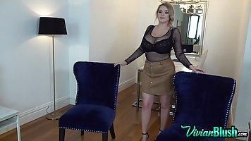 Busty blonde plumper, Vivian Blush is slowly taking off her ...