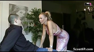 German blonde is teaching a younger guy a proper way to fuck...