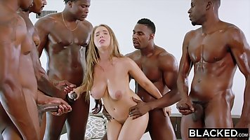 Horny black guys have gathered up to fuck Lena Paul at the s...