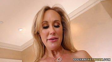 Racy blonde milf, Brandi Love is gently sucking two hard, bl...