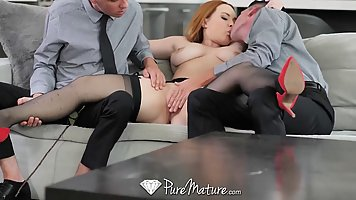 Horny, red haired woman is doing it with two guys she likes ...