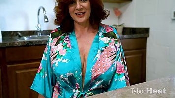 Red haired housewife is showing her big tits and kneeling on...
