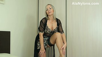 Astonishing mature blonde is wearing her best erotic lingeri...