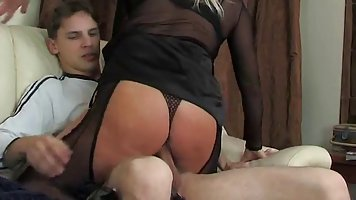 Hot woman caught her step- son masturbating in the living ro...