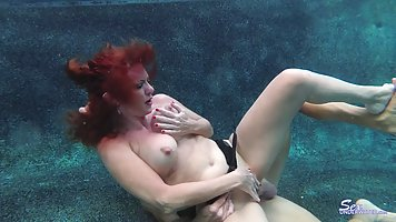Red haired mature, Andi James is playing with her big boobs ...