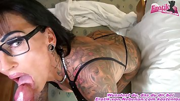 Tattooed, German woman with glasses is giving blowjobs and t...