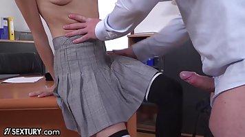 Euro schoolgirl is kneeling in front of her teacher and suck...
