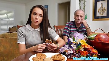 Barely legal brunette got down and dirty with two elderly gu...