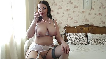 Brunette with big, saggy tits is wearing stockings and high ...