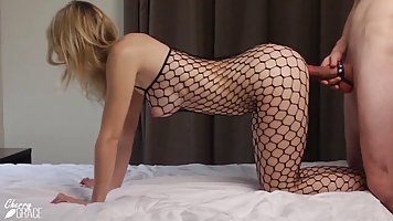 Stunning blonde in a black, fishnet costume is only thinking...