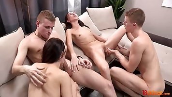 Jessica Malone and Lily Cat are having group sex in the livi...
