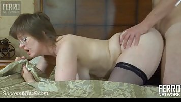 Nerdy mommy is wearing glasses and black stockings while get...