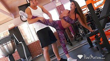 Reena Sky is doing her stretching routine knowing that she i...