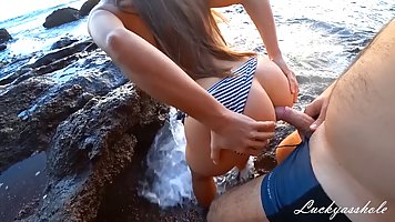 Naughty girl is about to get fucked on the beach until she g...