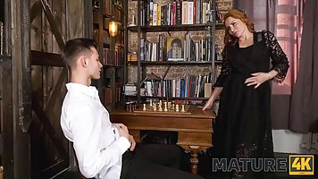 Red haired lady is sucking a younger guy's dick bef...