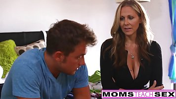 Busty blonde woman, Julia Ann is having a threesome with her...