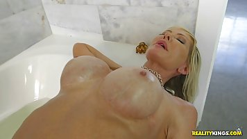 Busty blonde woman was having a bath when a man came into he...