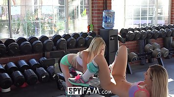 Two flexible teens are having lots of fun in the gym, while ...