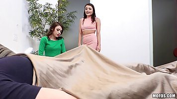 Two girls, Adria Rae and Lucy Kline are taking turns sucking...