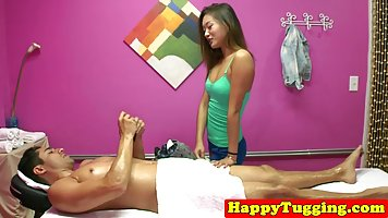 Asian teen is giving a nice handjob to her client, while in ...