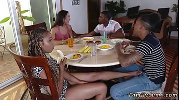 Black babe was giving a footjob under the table to a guy she...