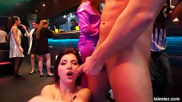 Horny ladies are having group sex in the night club and enjo...