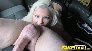Slutty blonde woman with big tits is spreading her legs wide...