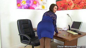 Dark haired, British milf is drilling her pussy with a black...