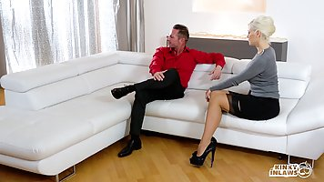 Hot ladies are having a threesome on the couch, with a guy t...