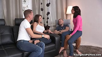 Two super sexy ladies are having a casual foursome, with guy...