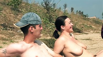 Busty brunette is often going to a nudist beach and having g...
