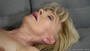 Szuzanne is a mature, blonde woman who likes to fuck her you...
