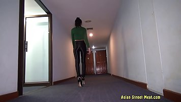 Slender Thai babe in green shirt and black pants is working ...