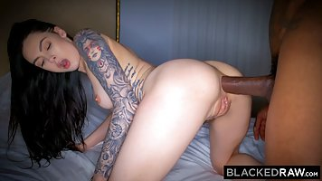 Canadian brunette with tattooed arm is having sex with a bla...